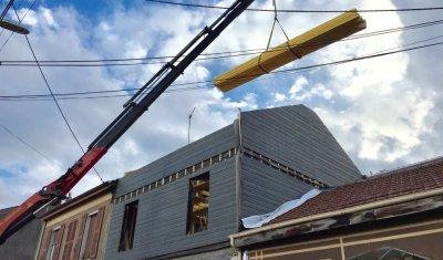 Construction d'une surélévation en ossature bois pour une maison individuelle vers Francheville